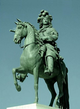 The statue of the sun king Louis XIV by Pierre Cartellier and Louis Petitot in front of the Palace of Versailles