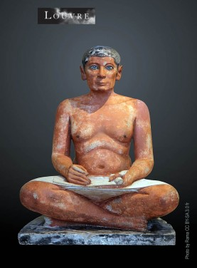 The statue of the egyptian seated scribe discovered in Saqqara in 1850. Exposed in the Louvre museum